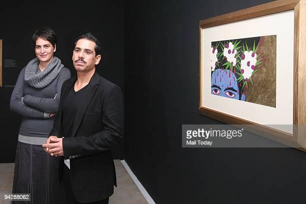 Priyanka Gandhi Vadra with her husband Robert Vadra during an exhibition of Paintings of Namrita Bachchan at Palette Art Gallery