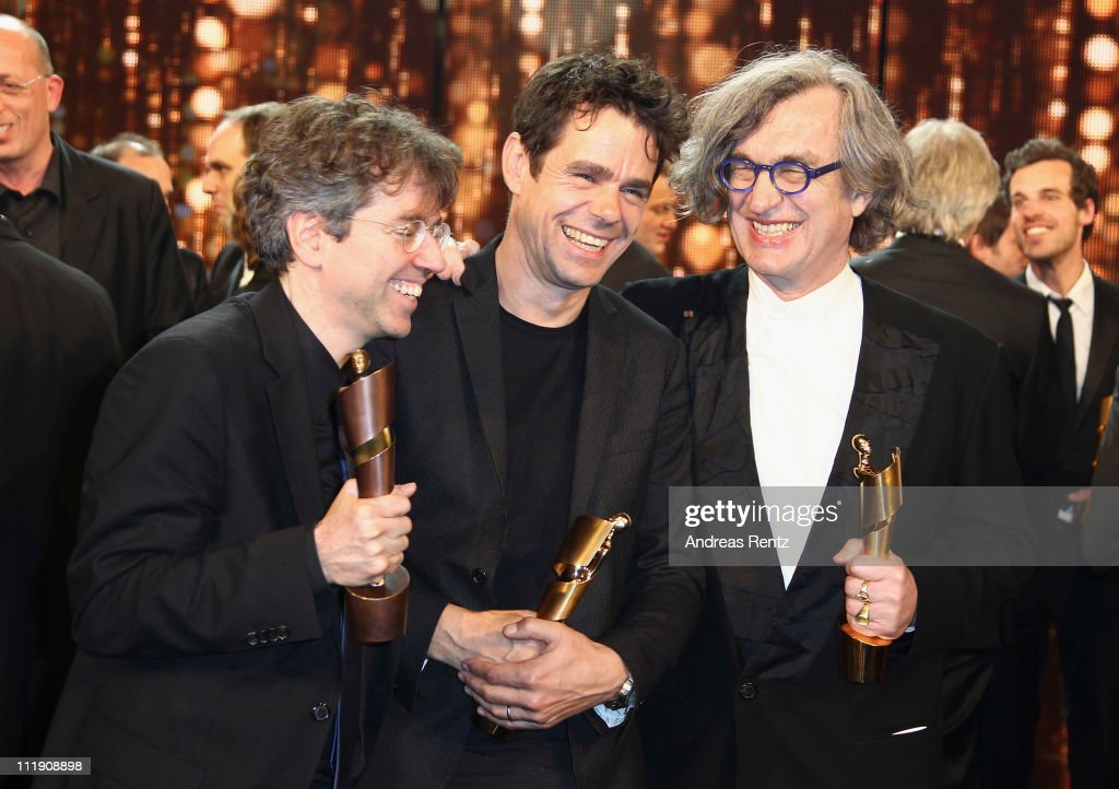 Prize winners and director Andres Veitel Tom Tykwer and Wim Wenders during the German Film Award 2011 at Friedrichstadtpalast on April 8 2011 in...