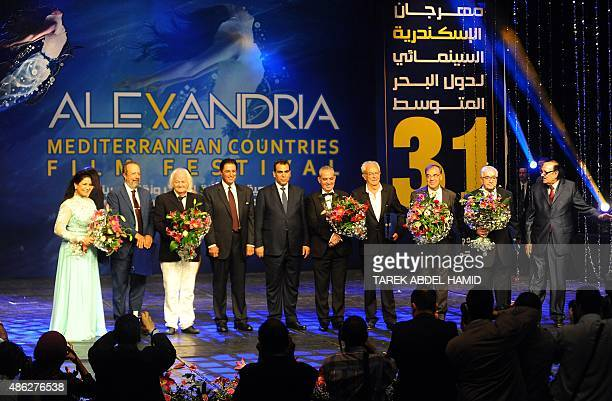 Prize winners of the Alexandria Mediterranean countries film festival stand on stage during the opening ceremony in Egypt's northern coastal city of...