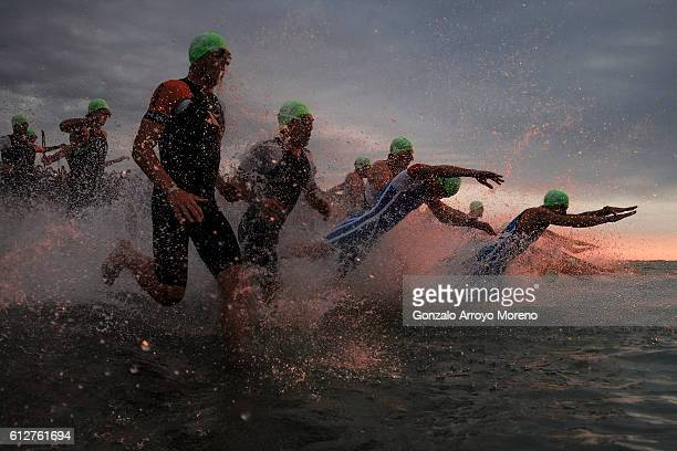 Pro athletes start the swimming course of the Ironman Barcelona on October 2 2016 in Calella Spain