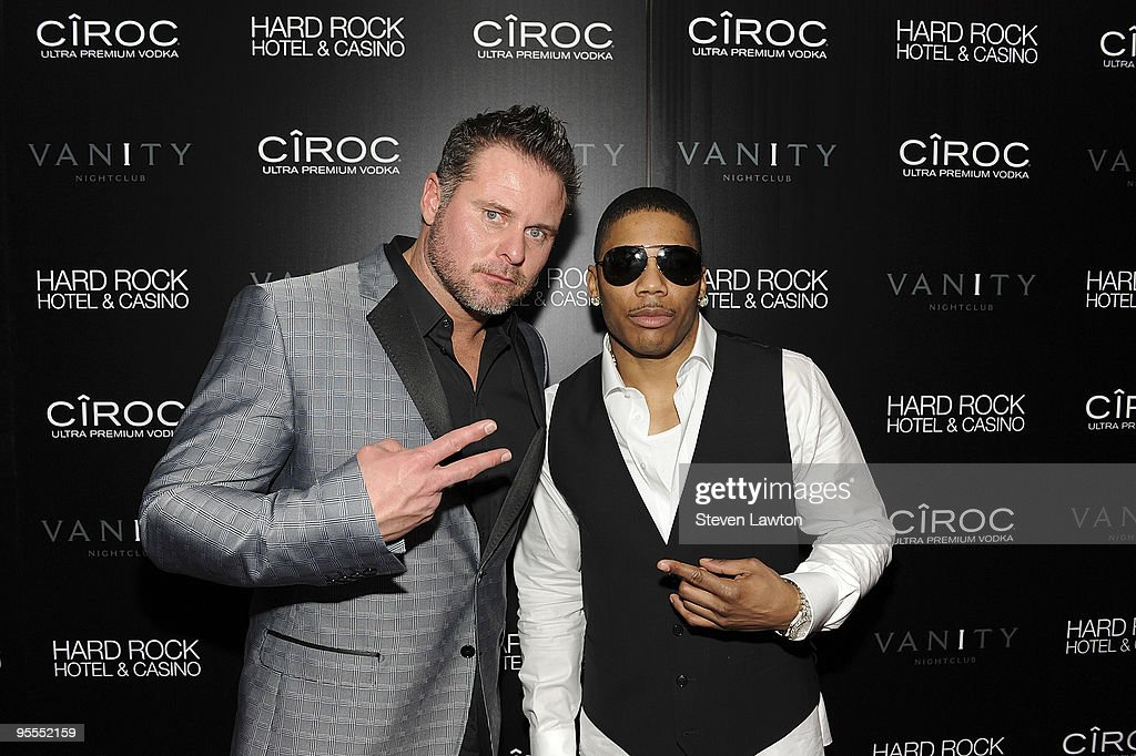 Pro baseball player Jason Giambi (L) and recording artist Nelly attend the grand opening of the Vanity nightclub hosted by Sean Diddy Combs at the Hard Rock Hotel and Casino on January 2, 2010 in Las Vegas, Nevada.