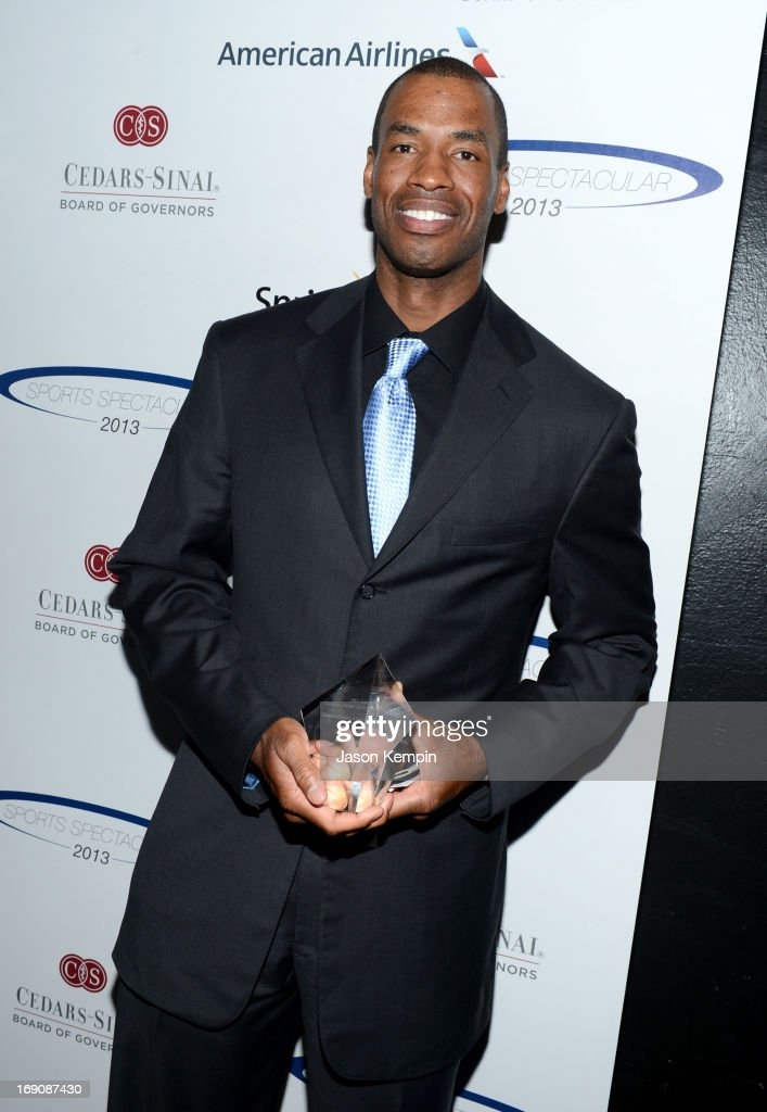 Pro basketball player <a gi-track='captionPersonalityLinkClicked' href=/galleries/search?phrase=Jason+Collins+-+Basketball+Player&family=editorial&specificpeople=201926 ng-click='$event.stopPropagation()'>Jason Collins</a> poses with the Inspirational Athlete of the Year Award at the 28th Anniversary Sports Spectacular Gala at the Hyatt Regency Century Plaza on May 19, 2013 in Century City, California.