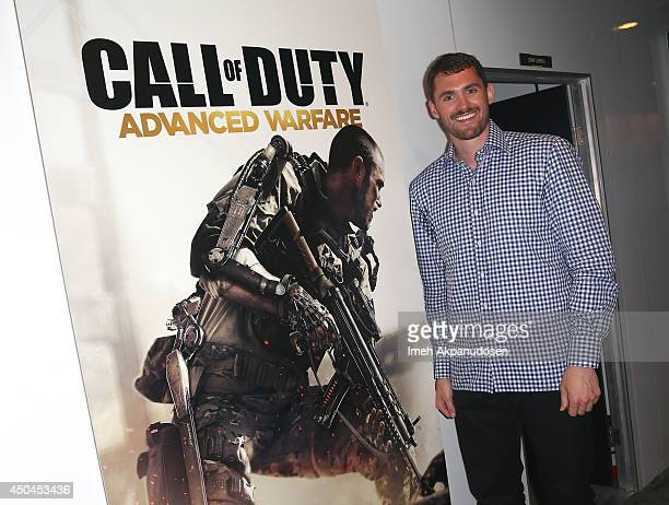 Pro basketball player Kevin Love visits Call of Duty Advanced Warfare at the Activision booth during E3 on June 11 2014 in Los Angeles California