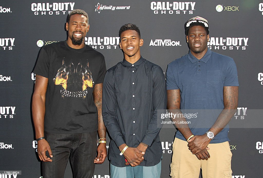Pro Basketball Players <a gi-track='captionPersonalityLinkClicked' href=/galleries/search?phrase=DeAndre+Jordan&family=editorial&specificpeople=4665718 ng-click='$event.stopPropagation()'>DeAndre Jordan</a> of the LA Clippers, Nick Young of the LA Lakers, and Anthony Bennett of the Cleveland Cavaliers attend 'Call Of Duty: Ghosts' Multiplayer Global Reveal at LA Live on August 14, 2013 in Los Angeles, California.