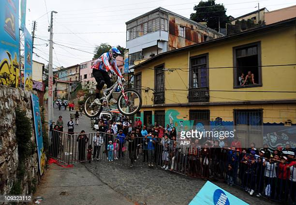 A Pro bike downhill rider realizes a jump during the 9th version of Valparaiso urban downhill race in Chile on February 20 2011 AFP PHOTO/Claudio...
