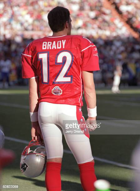 Pro bowl quarterback Tom Brady of the AFC watches the action from the sideline during the NFL Pro Bowl on February 13 2005 at Aloha Stadium in...