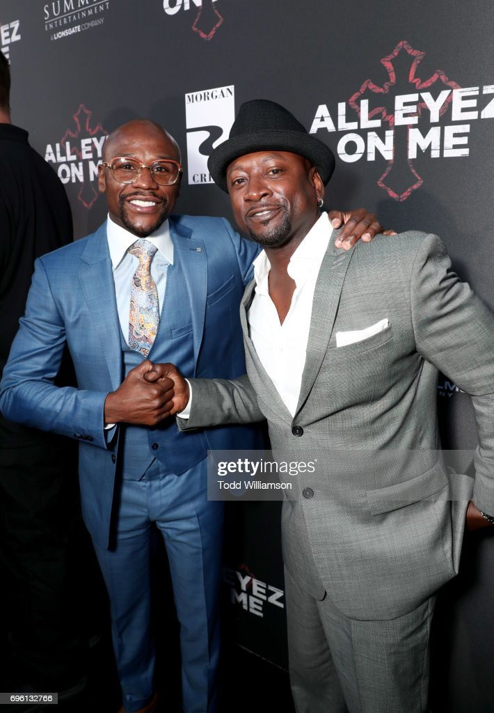 Pro boxer Floyd Mayweather (L) and guest at the 'ALL EYEZ ON ME' Premiere at Westwood Village Theatre on June 14, 2017 in Westwood, California.