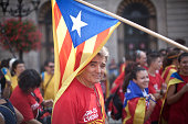 Pro Catalonia Independence protester under a Catalonian flag during the Independence Day demonstration Spanish Nationalists held a demonstration on...