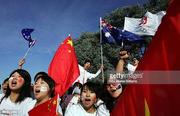 Pro Chinese supporters wave flags during the Olympic Torch relay at Commonwealth Park on April 24 2008 in Canberra Australia The relay route in the...