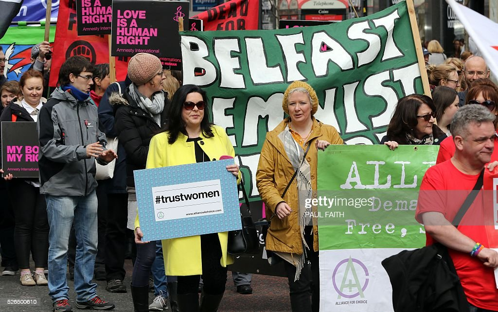 Pro choice campaigners take part in a demonstration through Belfast city centre on April 30, 2016. Abortion prosecutions in Northern Ireland have forced the issue to centre of the campaign ahead of next week's regional elections, with unprecedented political support for an end to the current ban. Northern Ireland currently bans abortion in all cases except when the life of the mother is in danger / AFP / PAUL
