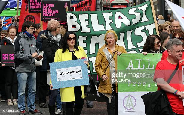 Pro choice campaigners take part in a demonstration through Belfast city centre on April 30 2016 Abortion prosecutions in Northern Ireland have...