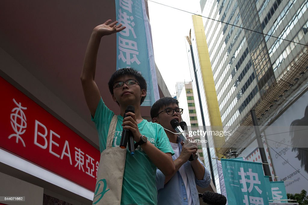 Pro Democracy protesters march as the city marks the 19th anniversary of the handover from Uk to China.