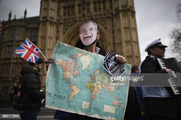 Pro EU protestors take part in a demonstration near Parliament on March 29 2017 in London England Today British Prime Minister Theresa May addresses...