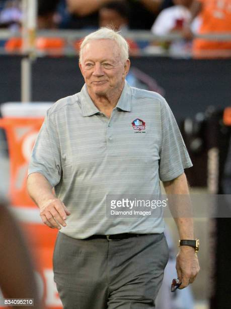 Pro Football Hall of Fame enshrinee owner/general manager Jerry Jones of the Dallas Cowboys walks onto the field as he is introduced to the crowd...
