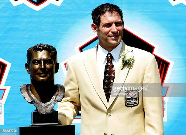 Pro Football Hall of Fame enshrinee Steve Young of the San Francisco 49ers poses with his bust during the 2005 NFL Hall of Fame enshrinement ceremony...