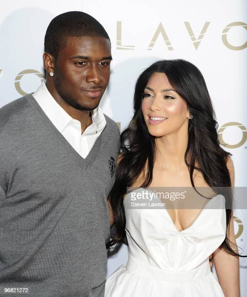 Pro football player Reggie Bush and television personality Kim Kardashian arrive for 'Queen Of Hearts' ball at Lavo Restaurant Nightclub at The...