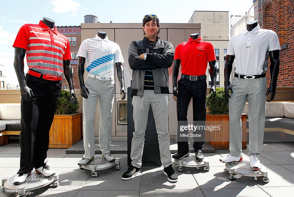Pro Golfer <a gi-track='captionPersonalityLinkClicked' href=/galleries/search?phrase=Bubba+Watson&family=editorial&specificpeople=597658 ng-click='$event.stopPropagation()'>Bubba Watson</a> poses for a photo in front of his full Master's scripting at during the Oakley Global Media Event at Gansevoort Park Avenue hotel on April 2, 2013 in New York City.