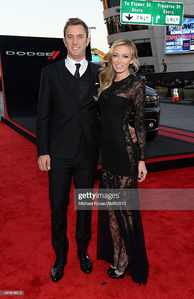 Pro golfer Dustin Johnson and model Paulina Gretzky attend the 2013 American Music Awards Powered by Dodge at Nokia Theatre LA Live on November 24...