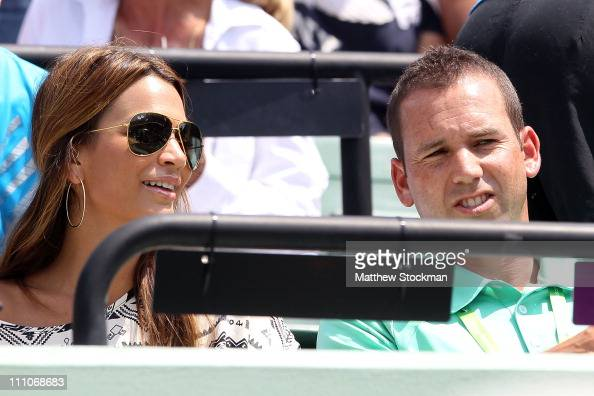 Pro golfer Sergio Garcia and Stacey Gardner the wife of tennis player Mardy Fish watches Fish's match against Juan Martin Del Potro of Argentina...