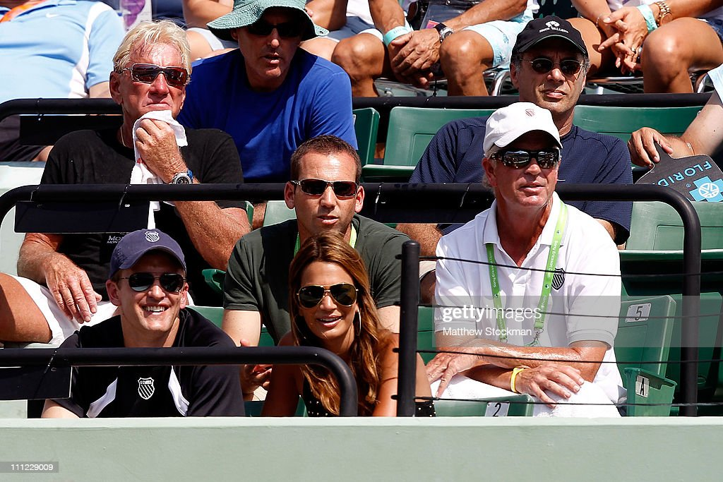 Pro golfer Sergio Garcia (top center) and Stacey Gardner, the wife of tennis player Mardy Fish, watch Fish's match against David Ferrer of Spain during the Sony Ericsson Open at Crandon Park Tennis Center on March 30, 2011 in Key Biscayne, Florida.