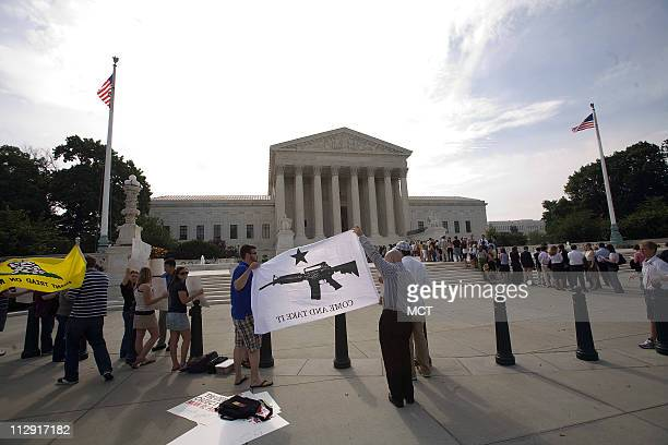 Pro gun activists stand outside the Supreme Court on Capitol Hill in Washington DC June 26 2008 A sharply divided Supreme Court on Thursday ruled...