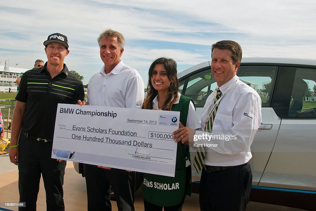 PGA TOUR pro <a gi-track='captionPersonalityLinkClicked' href=/galleries/search?phrase=Hunter+Mahan&family=editorial&specificpeople=885292 ng-click='$event.stopPropagation()'>Hunter Mahan</a> and BMW of North America Executive Vice President Peter Miles present a $100,000 Evans Scholarship donation to Scholar Yesenia Juarez and Western Golf Association President and CEO John Kaczkowski at the 2013 BMW Championship on September 14, 2013 in Lake Forest, Illinois. BMW donated the scholarship because Mahan was the first to hit a hole-in-one during the 2013 BMW Championship.