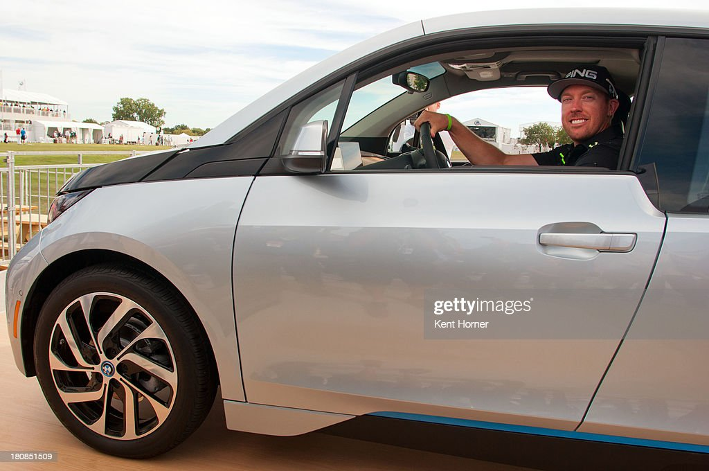 PGA TOUR pro <a gi-track='captionPersonalityLinkClicked' href=/galleries/search?phrase=Hunter+Mahan&family=editorial&specificpeople=885292 ng-click='$event.stopPropagation()'>Hunter Mahan</a> sits inside the all-new BMW i3 that he just won at the 2013 BMW Championship on September 14, 2013 in Lake Forest, Illinois. Mahan was awarded the BMW i3 because he hit a hole-in-one on Conway Farm's 17th hole. The BMW i3 is the first purpose-built electric vehicle to be made primarily of carbon fiber from the ground up.