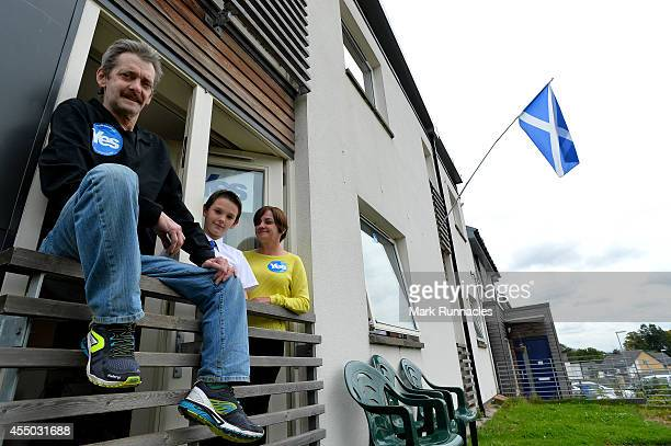 Pro Independence supporter William Young of Easterhouse looks from his window with his family Son Paul and wife Karen on September 9 2014 in Glasgow...