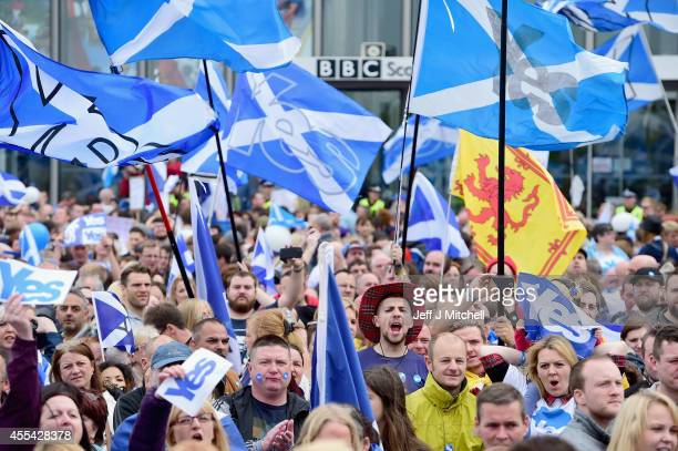 Pro independence supporters march through Glasgow on route to the BBC Scotland where they staged a protest against their perceived bias on September...