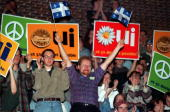 Pro Independence Yes supporters cheer during a speech by Bloc Quebecois Leader Lucien Bouchard at a junior college in Montreal 24 October The vote on...