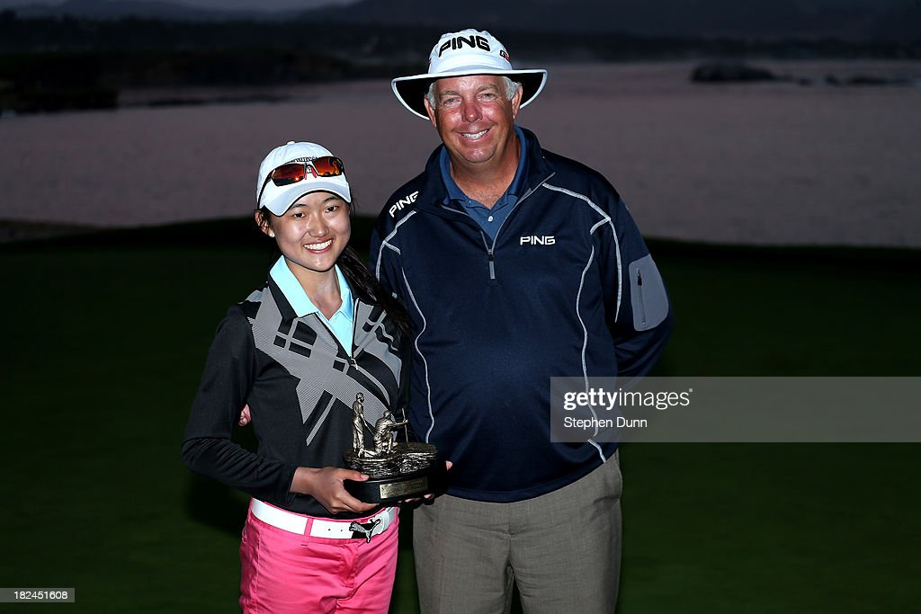 Pro Junior winning team Michelle Xie and Kirk Triplett pose for photos after the final round of the Nature Valley First Tee Open at Pebble Beach at Pebble Beach Golf Links on September 29, 2013 in Pebble Beach, California.