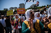Pro Kurdish supporters chant slogans and hold placards reading ' No to the coup peace right now ' during a rally against military coup and the state...