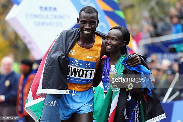 Pro Men's division winner Stanley Biwott of Kenya left poses with Pro Women's division winner Mary Keitany of Kenya during the 2015 TCS New York City...