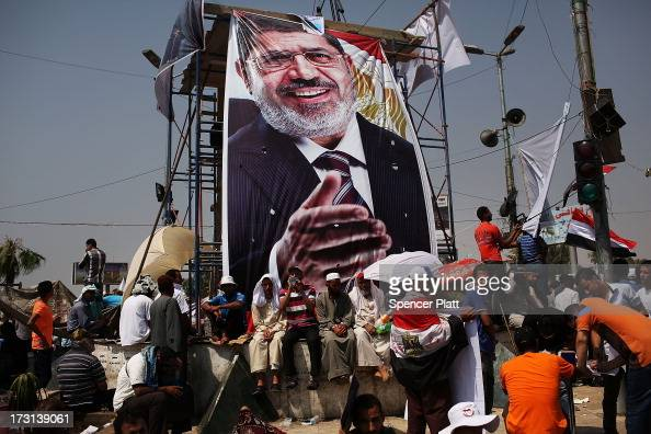 Pro Mohamed Morsi supporters attend a rally near where over 50 were purported to have been killed by members of the Egyptian military and police in...