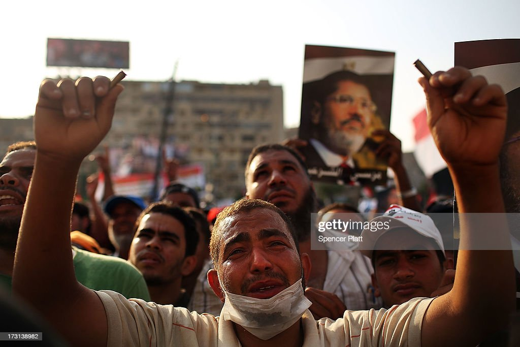 Pro Mohamed Morsi supporters rally near where over 50 were purported to have been killed by members of the Egyptian military and police in early morning clashes on July 8, 2013 in Cairo, Egypt. The military, which took over control of the country from Muslim Brotherhood leader Morsi last week, has denied that they opened fire on the protesters and claim the shootings resulted after they came under attack from members of the Muslim Brotherhood. Egypt continues to be in a state of political paralysis following the ousting of Morsi by the military. Adly Mansour, chief justice of the Supreme Constitutional Court, was sworn in as the interim head of state in a ceremony in Cairo on the morning of July 4.
