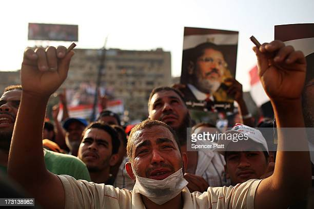 Pro Mohamed Morsi supporters rally near where over 50 were purported to have been killed by members of the Egyptian military and police in early...