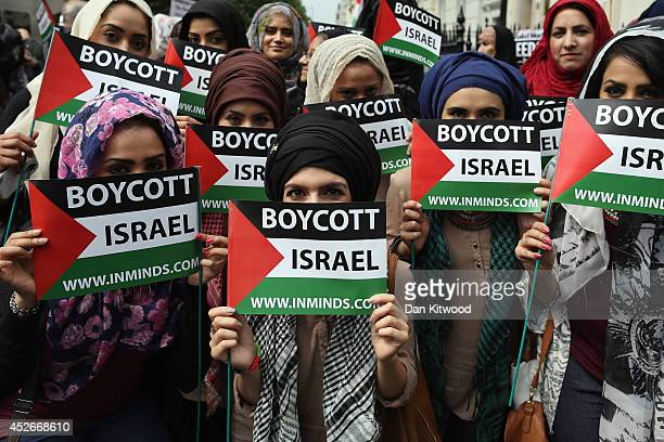 Pro Palestinian demonstrators march through central London on July 25 2014 in London England The march was to show solidarity with the Hamas ruled...