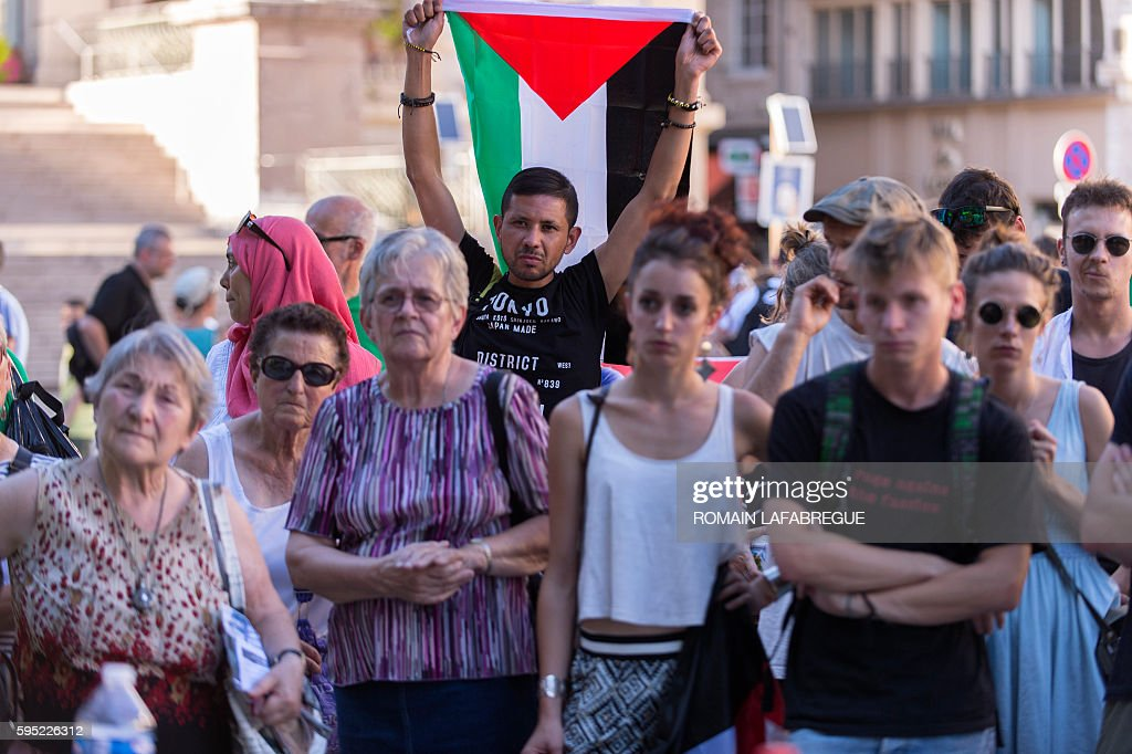Pro Palestinians demonstrators gather in front of the city hall in SaintEtienne central eastern France to protest against racism in football before...