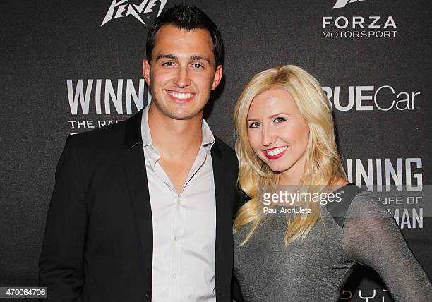 Pro Race Car Drivers Graham Rahal and Courtney Force attend the screening of 'WINNING The Racing Life Of Paul Newman' at the El Capitan Theatre on...
