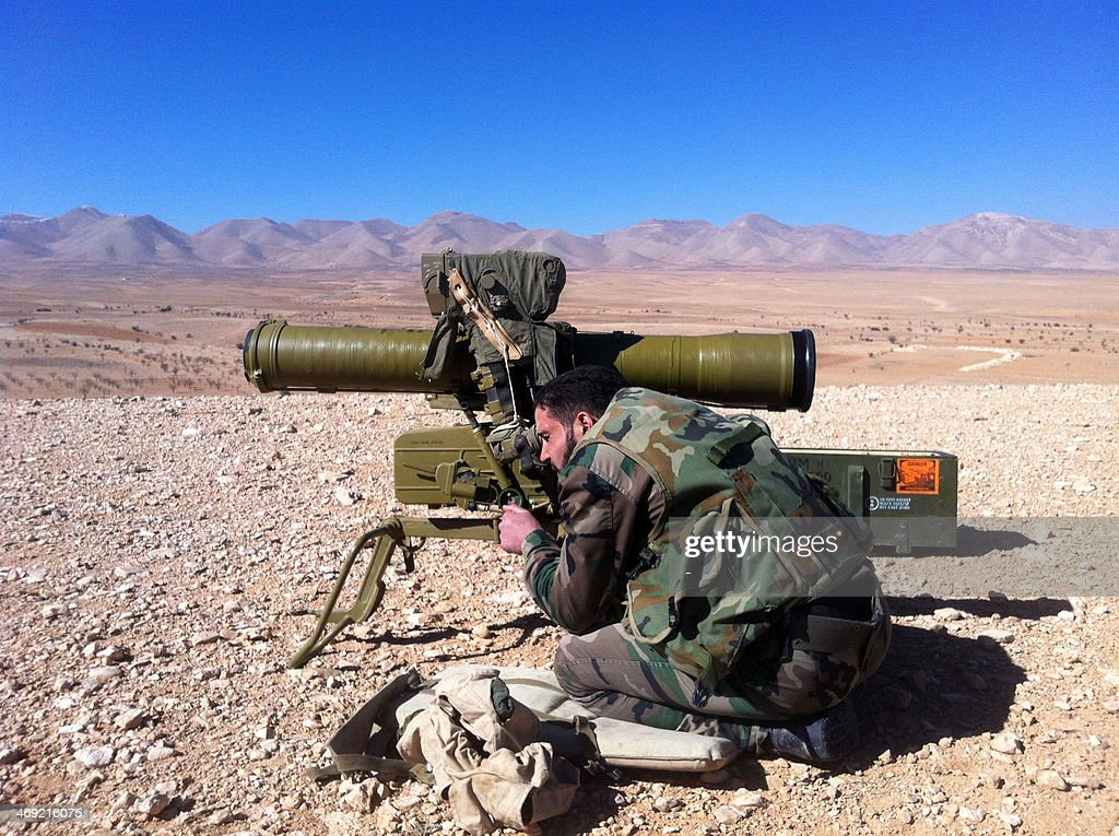 A pro regime soldier aims a rocket launcher towards rebel locations in the Qalamoun region on the outskirts of the Syrian capital Damascus on...