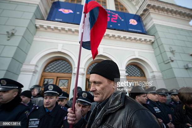 A pro russian demonstration headed toward a memorial site to deposit roses in Donetsk Ukraine on March 30 2014 in the mean time a group of protestors...