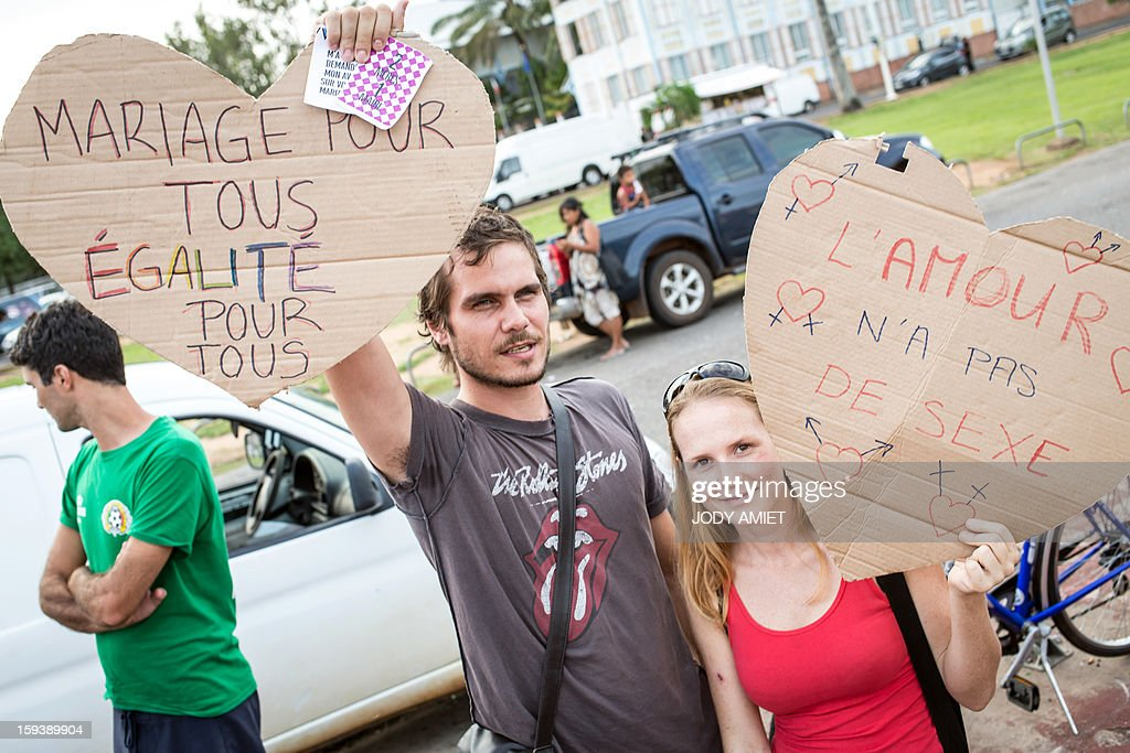 Pro same-sex marriage protesters hold placards reading 'Marriage for all, Equality for all' and 'Love has no gender', during a counter-demonstration of a march against plans to legalise same-sex wedding in Cayenne, in French Guiana, on January 12, 2013. Tens of thousands are set to march in Paris to denounce government plans to legalise same-sex marriage and adoption which have angered many Catholics and Muslims, France's two main faiths. The French parliament is to debate the bill -- one of the key electoral pledges of Socialist President at the end of this month.