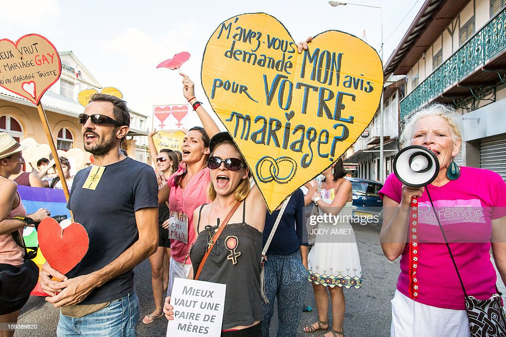 Pro same-sex marriage protesters shout slogans and hold placards during a counter-demonstration of a march against plans to legalise same-sex wedding in Cayenne, in French Guiana, on January 12, 2013. Tens of thousands are set to march in Paris to denounce government plans to legalise same-sex marriage and adoption which have angered many Catholics and Muslims, France's two main faiths. The French parliament is to debate the bill -- one of the key electoral pledges of Socialist President at the end of this month.