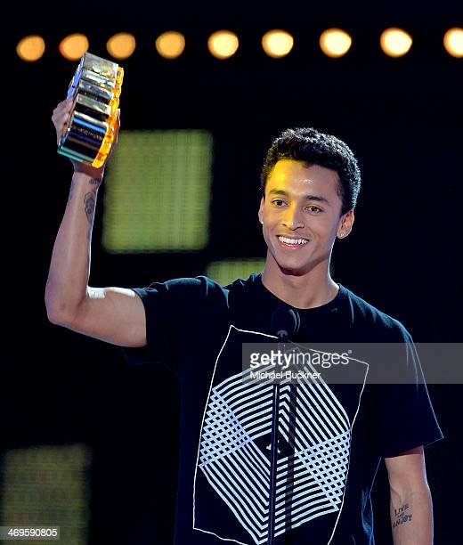 Pro skateboarder Nyjah Huston accepts the AltiDude award onstage during Cartoon Network's fourth annual Hall of Game Awards at Barker Hangar on...