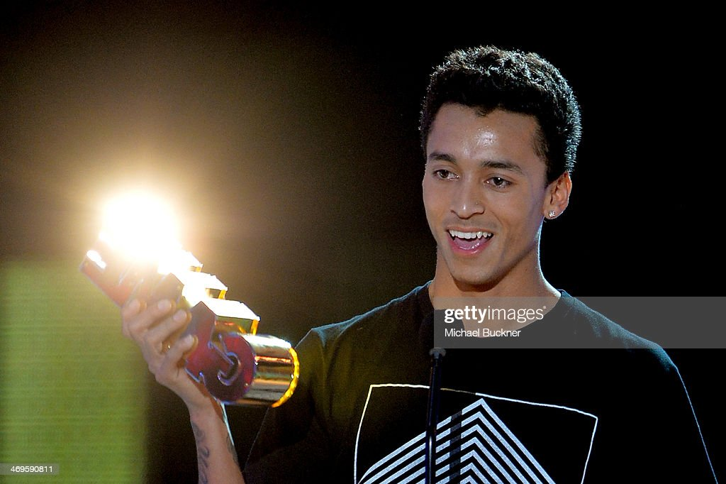 Pro skateboarder Nyjah Huston accepts the Alti-Dude award onstage during Cartoon Network's fourth annual Hall of Game Awards at Barker Hangar on February 15, 2014 in Santa Monica, California.