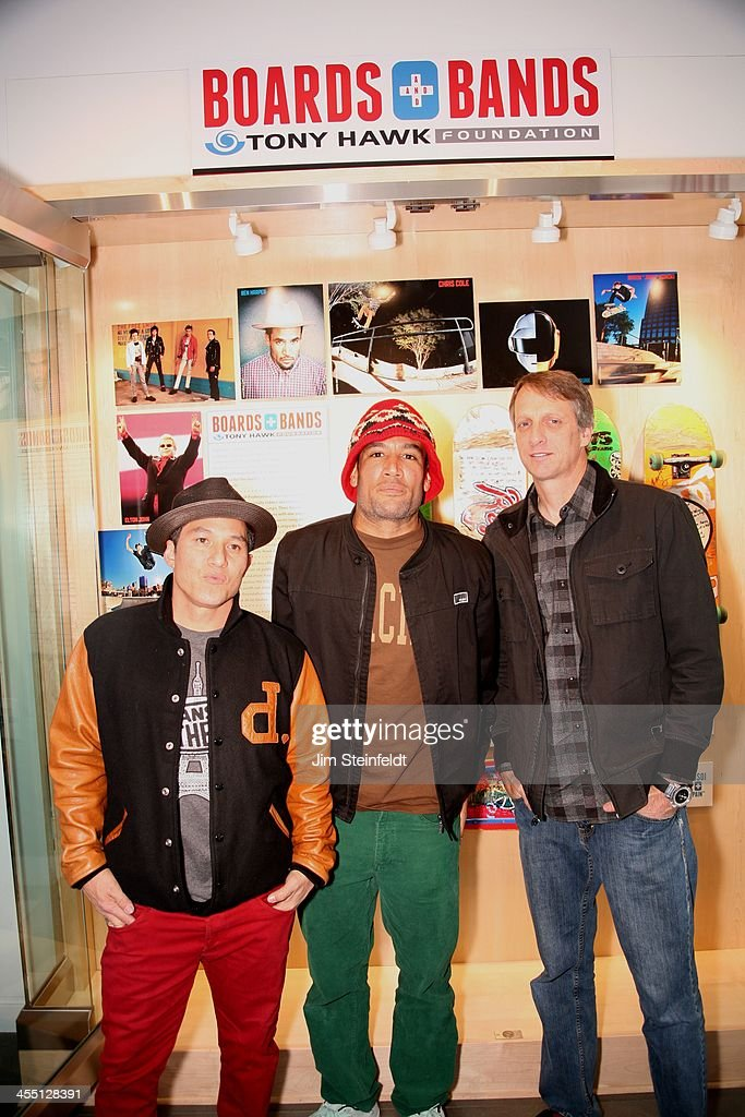 Pro Skateboarders Christian Hosoi and Tony Hawk with musician Ben Harper pose with skateboards autographed by Hoisoi Hawk Harper Mick Jones and Paul...