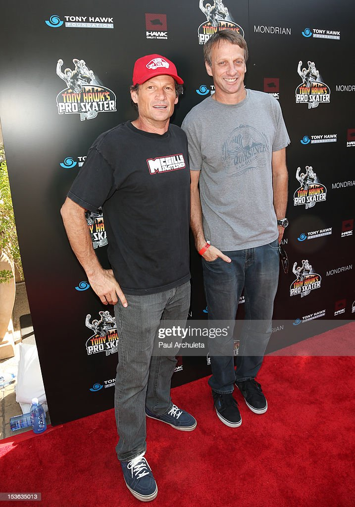 Pro Skateboarders Mike McGill (L) and <a gi-track='captionPersonalityLinkClicked' href=/galleries/search?phrase=Tony+Hawk+-+Skateboarder&family=editorial&specificpeople=201818 ng-click='$event.stopPropagation()'>Tony Hawk</a> (R) attend the 9th annual Stand Up For Skateparks benefit at Ron Burkle's Green Acres Estate on October 7, 2012 in Beverly Hills, California.