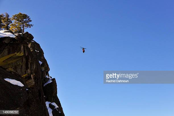 Pro skier Josh Daiek performs a double backflip ski BASE jumping off of Lovers Leap in Strawberry, CA.