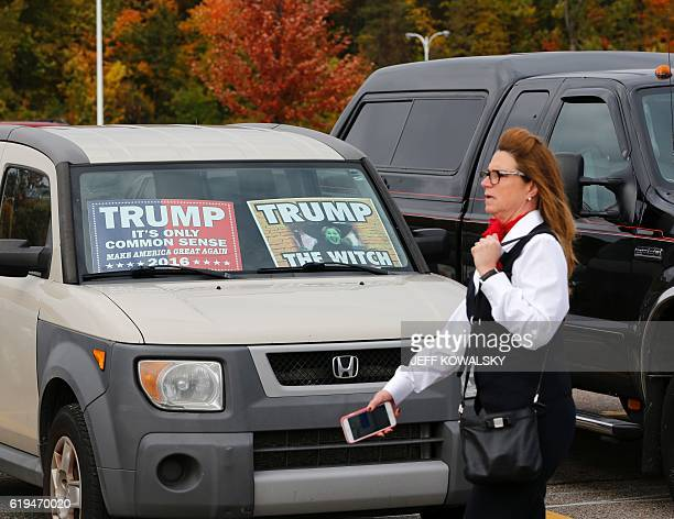 A pro Trump vehicle is seen in the lot outside of the venue where US Republican presidential nominee Donald Trump will speak at Macomb Community...