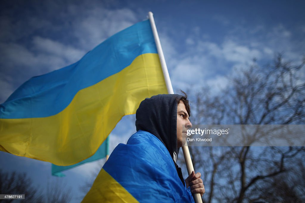A pro Ukrainian protester against the forthcoming referendum in Crimea walks along the road on March 14, 2014 in Simferopol, Ukraine. As the standoff between the Russian military and Ukrainian forces continues in Ukraine's Crimean peninsula, world leaders are pushing for a diplomatic solution to the escalating situation. Crimean citizens will vote in a referendum on 16 March on whether to become part of the Russian federation.